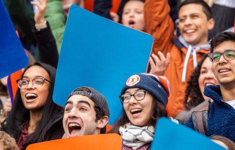Illini students holding up orange & blue cards