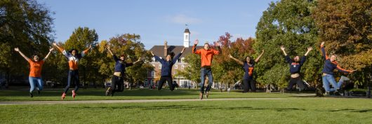 students jumping on the Quad