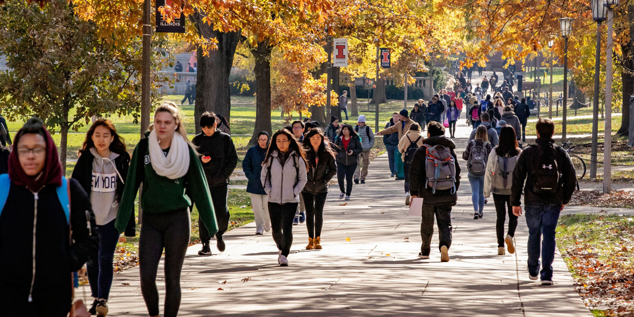 students walking campus between classes