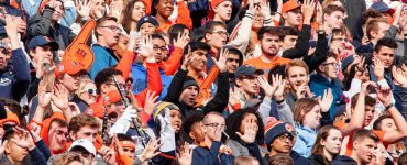 crowd of cheering students at an Illini football game