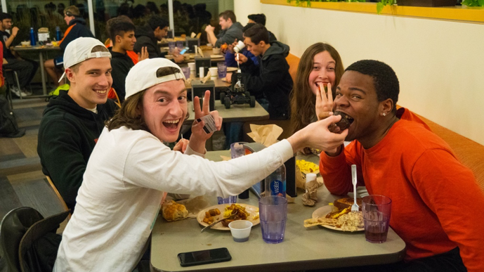 friends eating together in a dining hall
