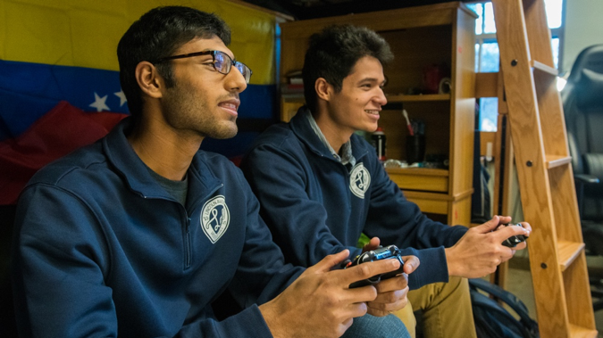 roommates playing video games together