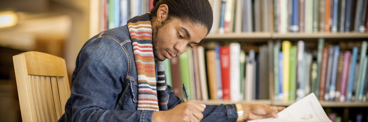 Student studying in ACES Library.