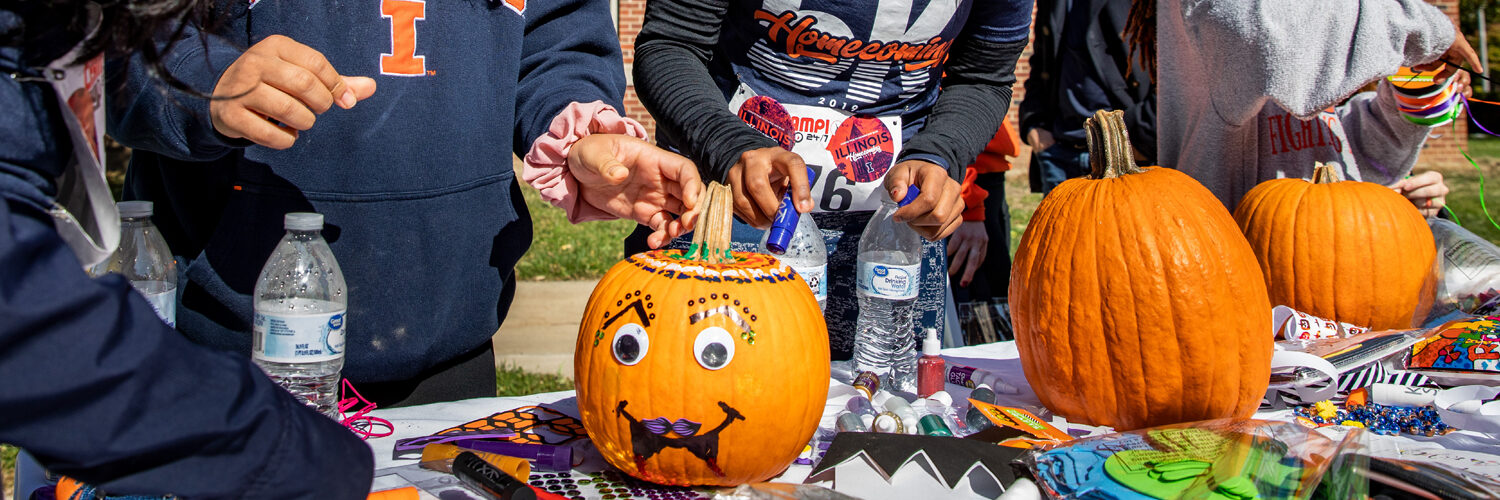 pumpkins are decorated for the season during the kickoff of the University of Illinois Homecoming celebration