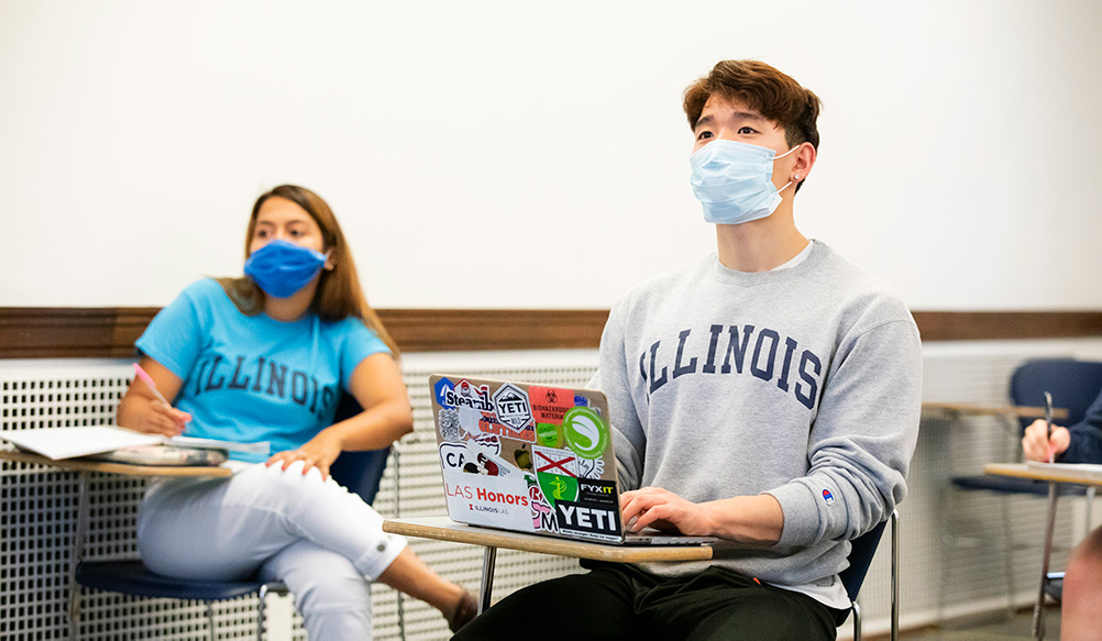 students with face coverings in a class listening
