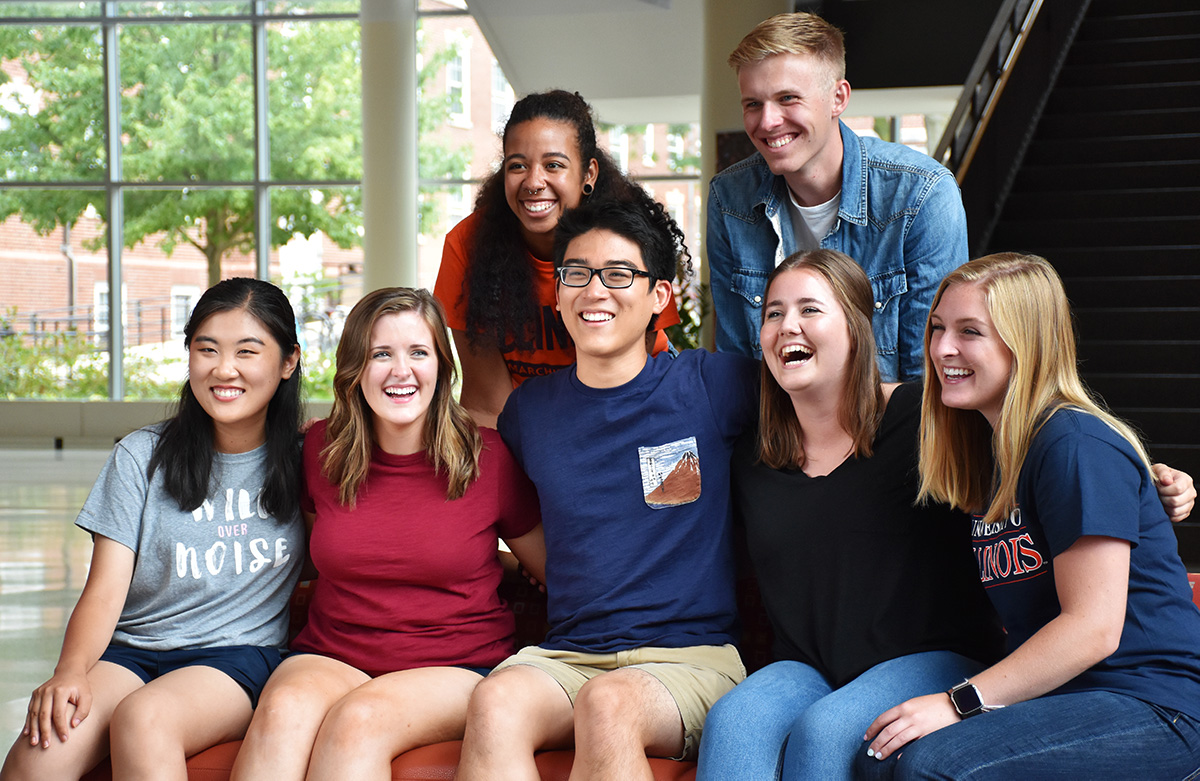 group of students and residence hall neighbors pose together in Ikenberry Commons