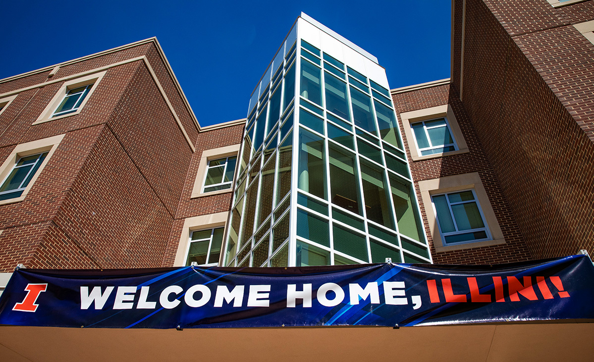 """""""Welcome Home, Illini"""" banner adorns the entrance to Bousfield Hall on move-in day"""