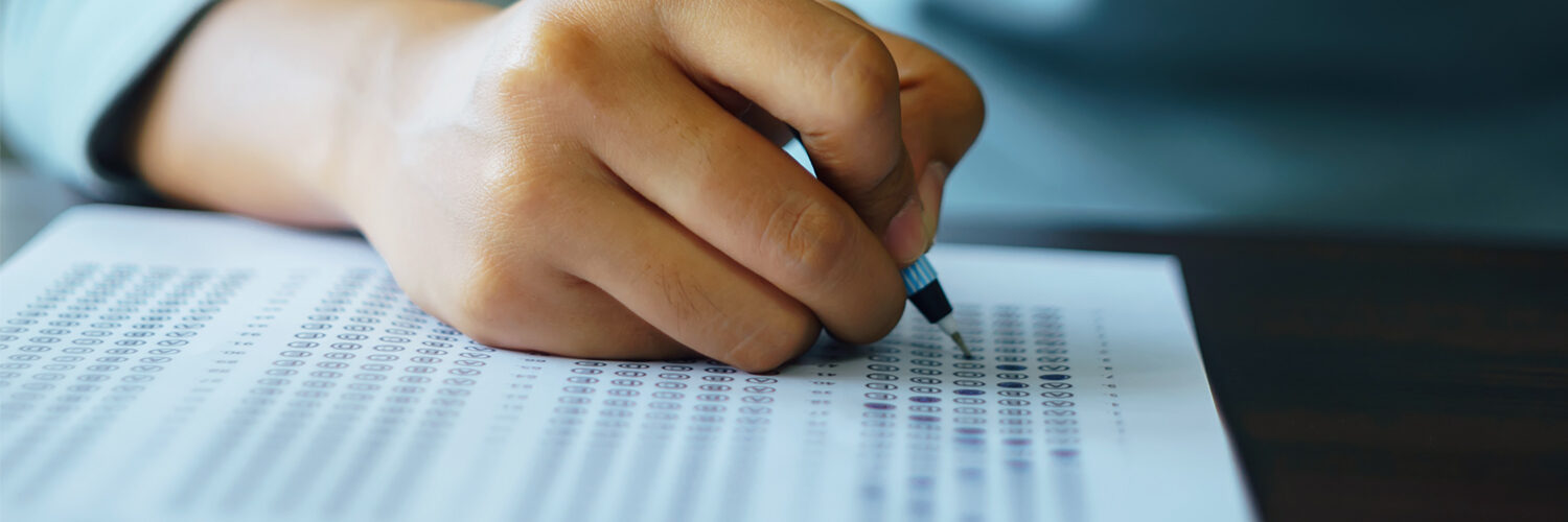 closeup of a student taking a scantron placement test