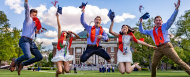 UIUC graduates celebrating with friends on the Quad