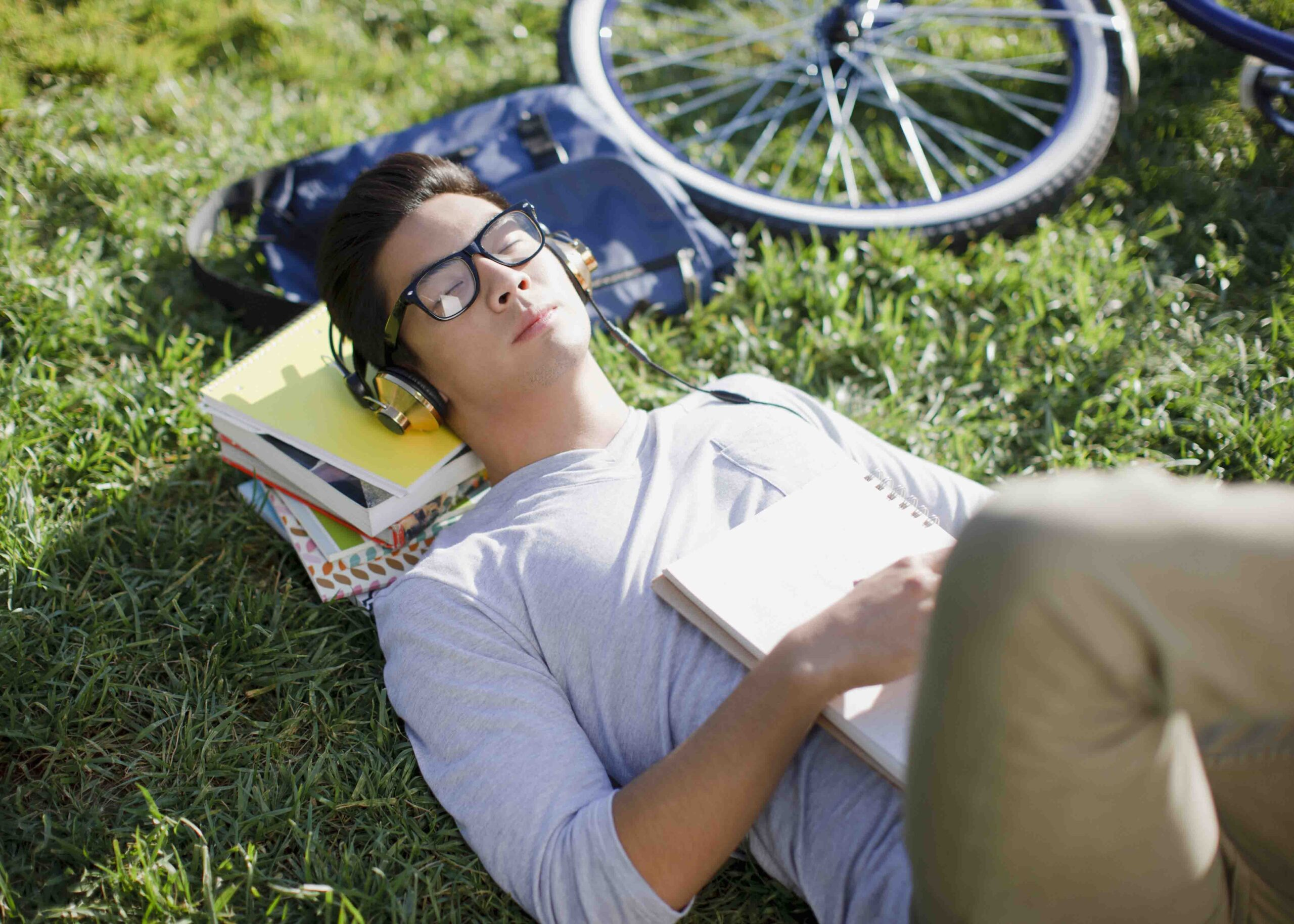 Student relaxing outdoors.